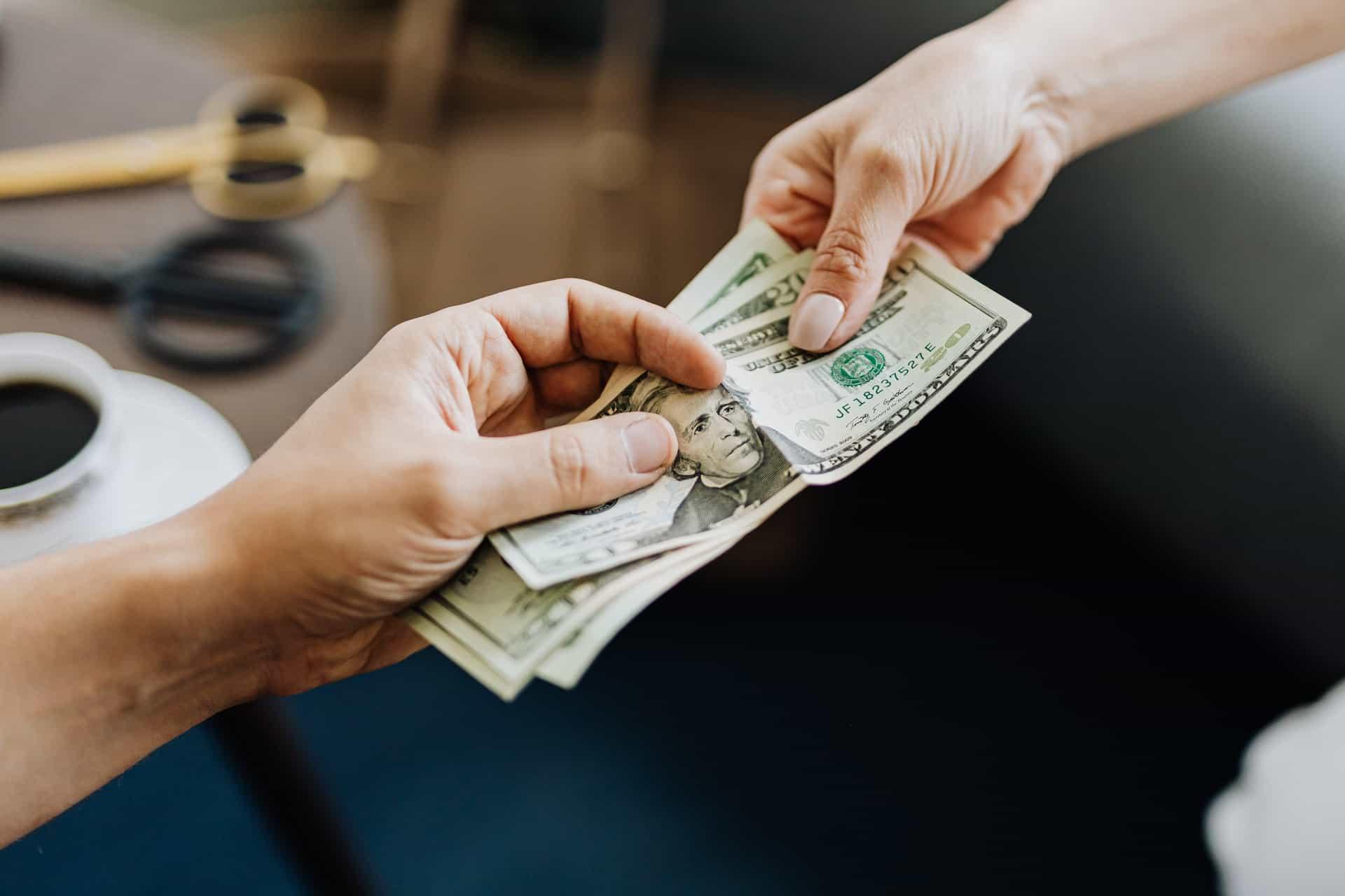 People passing around money