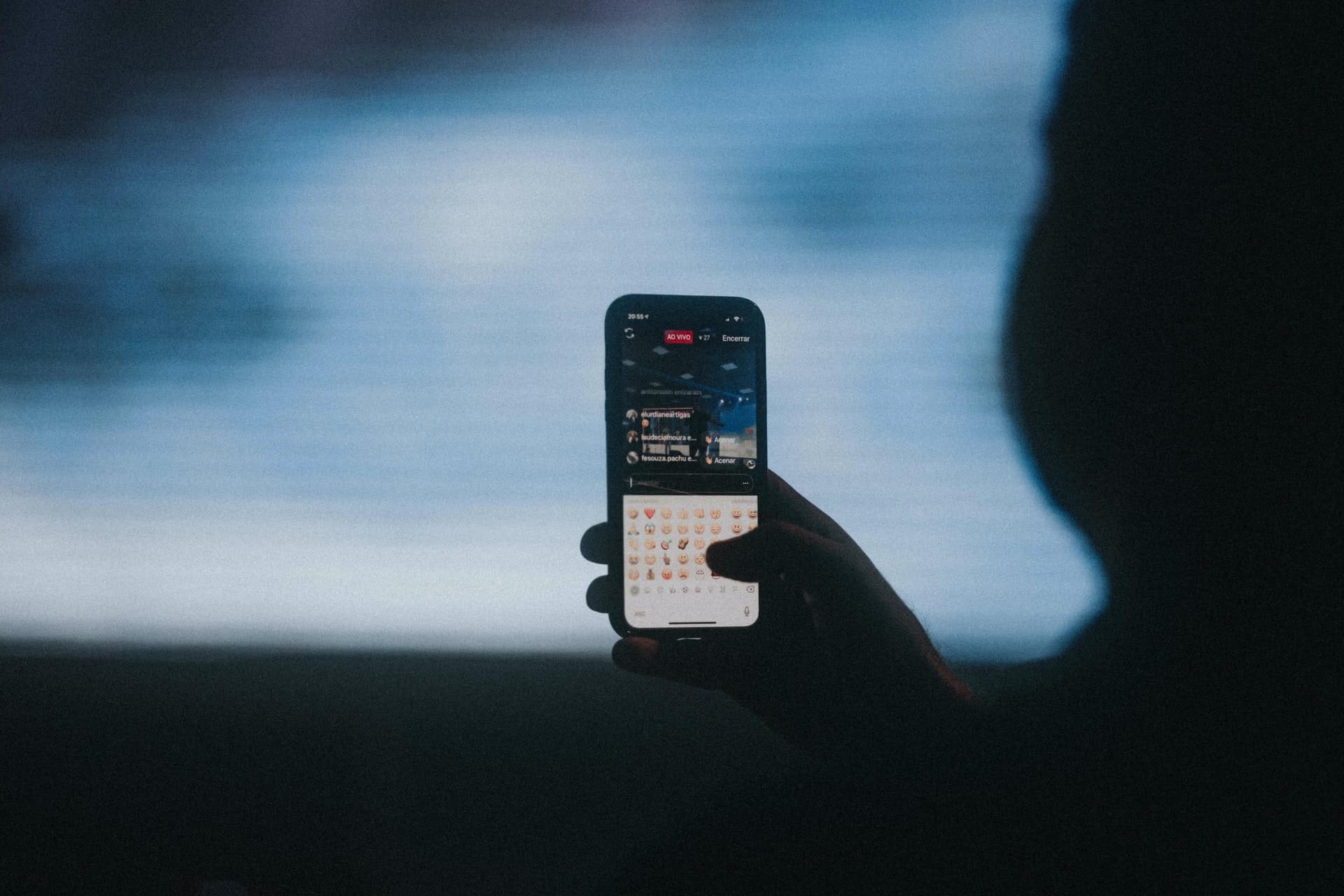 Person live streaming on phone