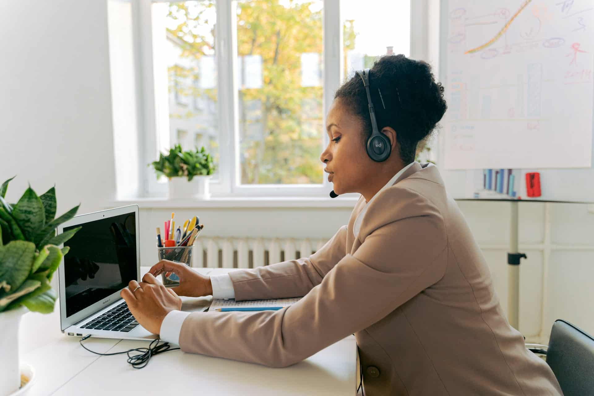 Female customer service agent using laptop