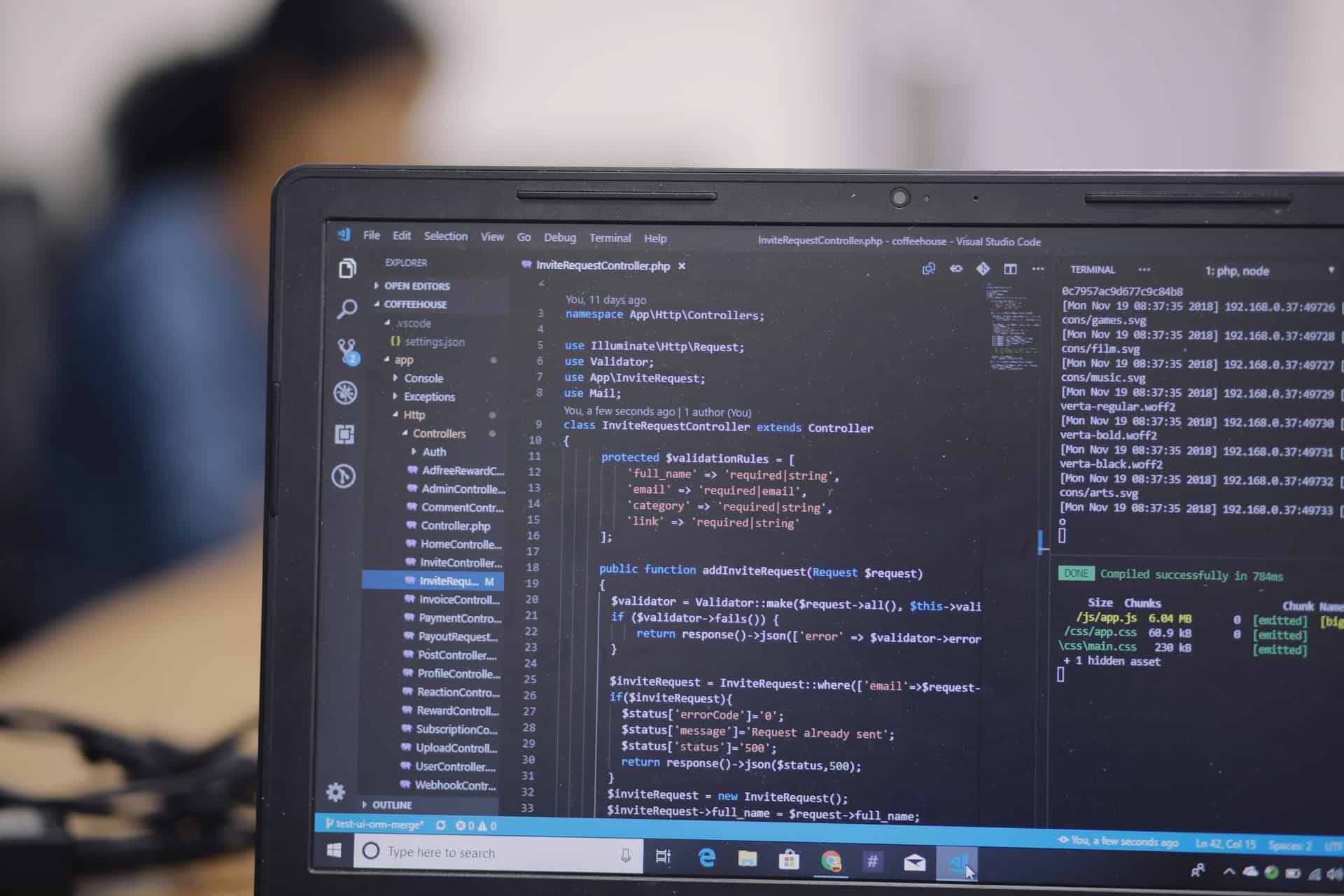 Code editor in dark mode open on laptop