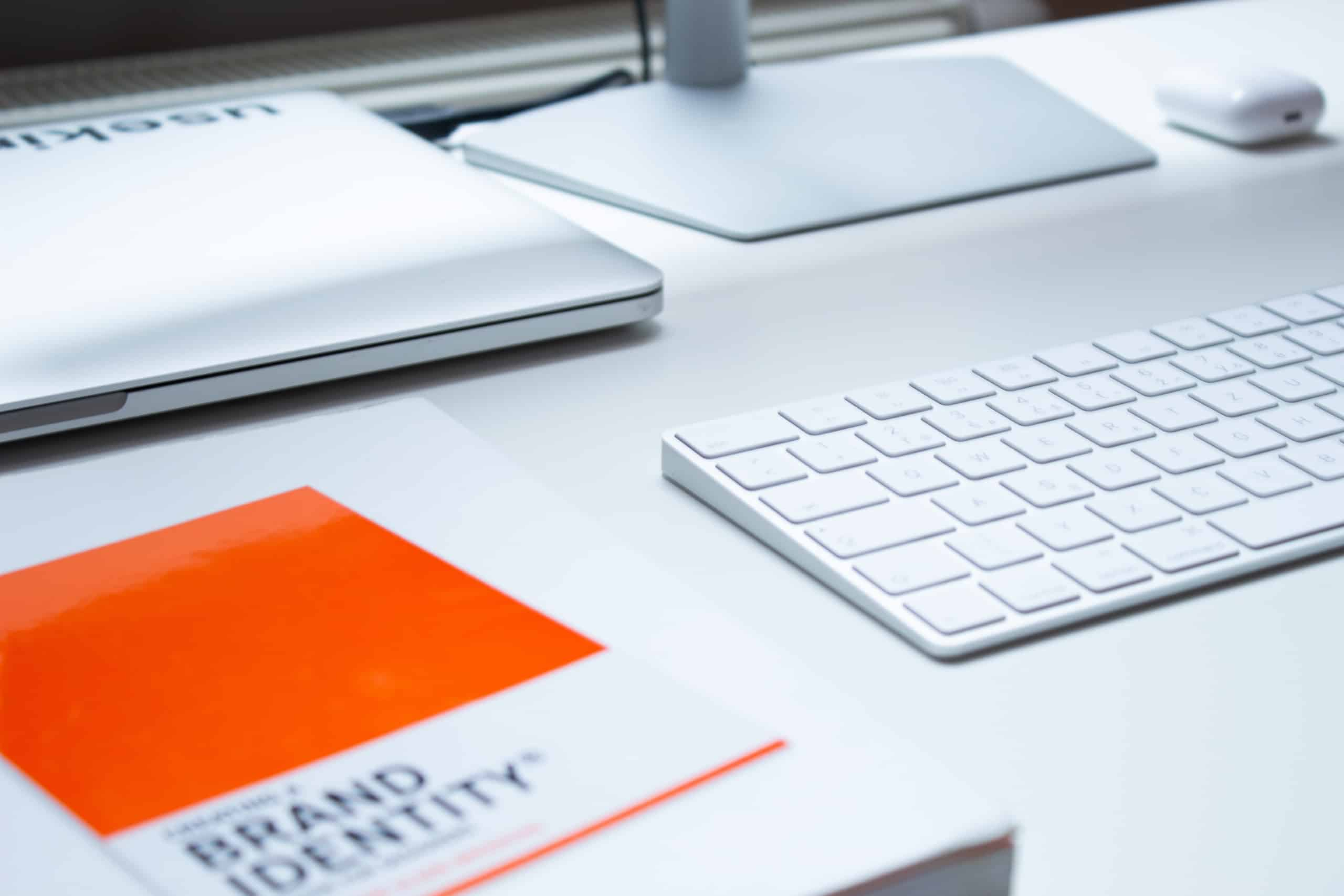 Book about brand identity on desk